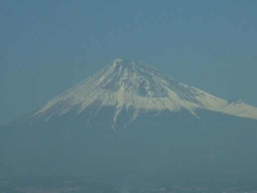 An incompetent photo of Mount Fuji from a bullet train nearing Tokyo.
