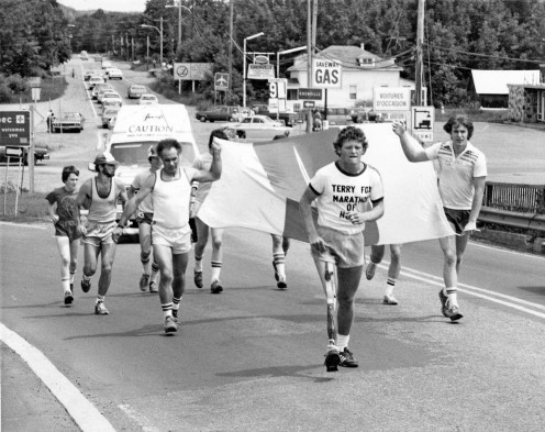 People running with Terry Fox during run across Canada