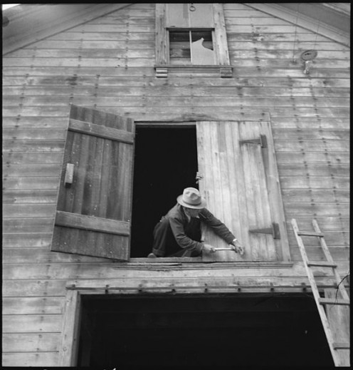 Nailing the hayloft door from the upcoming evacuation. War Relocation Authority centers where they will spend the duration when Germans occupied their country.