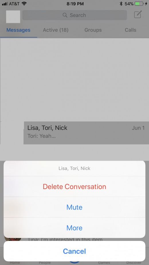 Navigate to the group conversation you want to remove yourself from. Hold your finger against that conversation until a context menu flies up from the bottom of the screen.