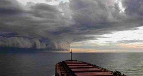 Seen from the bow of a Caribbean ship, Hurricane Harvey ominously makes its way toward the Texas coast.