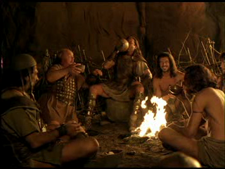 Odysseus (played by the great Armand Assante in the movie) and his mean, having their fill...