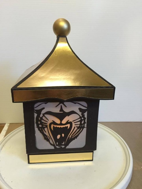 "Abby captured her high school colors of black and gold in this paper lantern, which has a ""Watson Chapel Wildcat"" on the front."