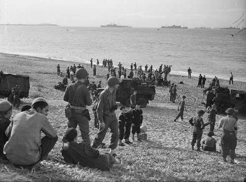 British and American soldiers on a beach in Algiers during Operation Torch.