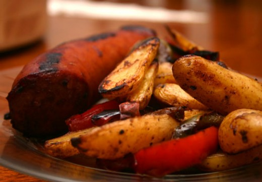 kielbasa sausage stir fry with onions, peppers, and fingerling potato wedges