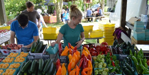 Large crowds pack the Ithaca Farmers Market on weekends for organic foods, meals and music.