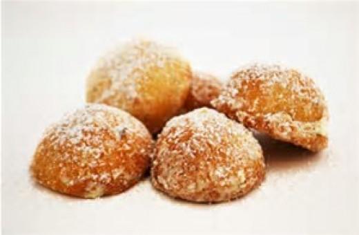 Russian Tea Cookies rolled in cinnamon and sugar