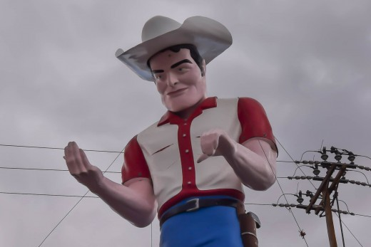 Muffler Men, like this cowboy in Gallup, NM, are icons of the American road.