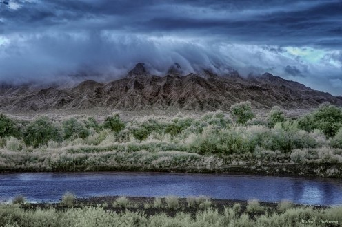 The Rio Grande River in front of the Sandia Mountains.  Imagine rafting down this river and seeing various wildlife, such as birds, bats, fish, geese, cranes, and many other critters.