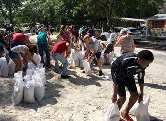 These people are getting ready for the oncoming hurricane. Now, this may sound confusing, but the name of Puerto Rico means a rich port, but today those people over there are not that rich, so, they need some outside help after the hurrinane damage.