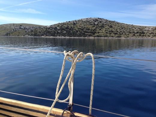 Island Veli Rasip, just before Piskera island comes. Piskera is bigger and has a marina.
