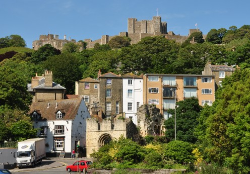 The ruins of St James's Church in Dover, Kent, with Dover Castle in the background.