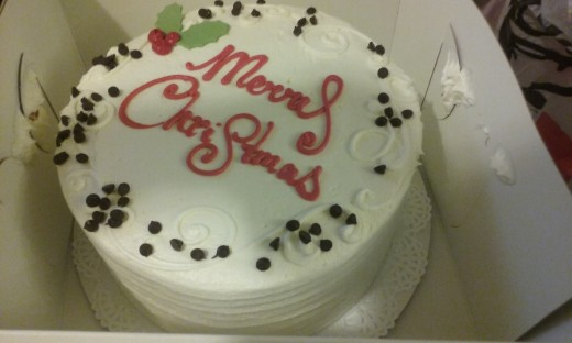 """An adorable and yes, delicious """"Merry Christmas"""" cake from Delicious bakery in Greensboro, North Carolina"""