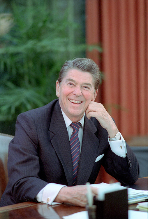 President Reagan's official portrait, posed at his Oval Office desk. 10/25/84.