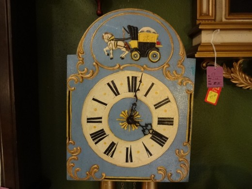 Clock in an antique store with The Carriage Driver theme
