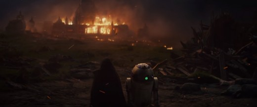 Luke and R2 in front of the burning temple.