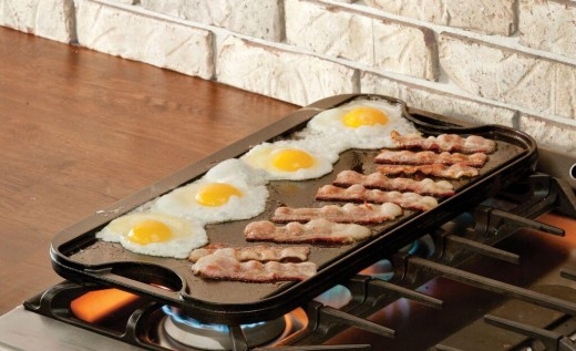 Cook eggs and sausages together without adding extra oil.
