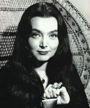 Morticia Addams (Carolyn Jones) sitting in her chair.