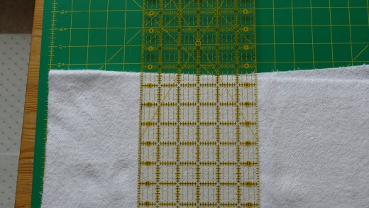 Most fabric when bought in multiple lengths come in one big bold. Cut a straight edge from one end, and then cut the fabric at a width of 11 inches.
