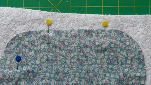 You will start sewing from the pin on the right using a 1/4 or 1/2 seam allowance.