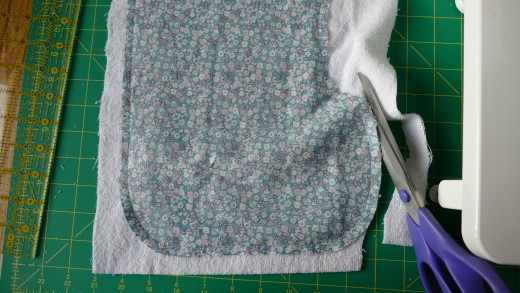 Cut around the pattern to get rid of the excess terrycloth fabric.