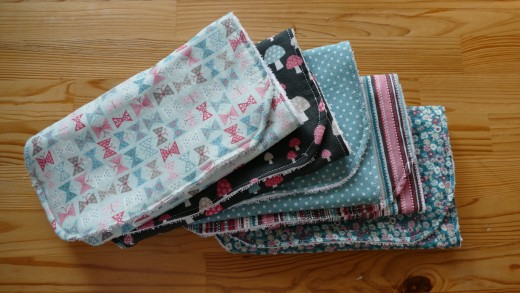 I managed to make a set of 5 Baby burp cloths using this pattern and a fat quarter pack.