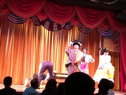 There are six actors that are mainly in pairs that sing and dance their way through different American folk songs. They are constantly trying to upstage each other and it is hilarious.