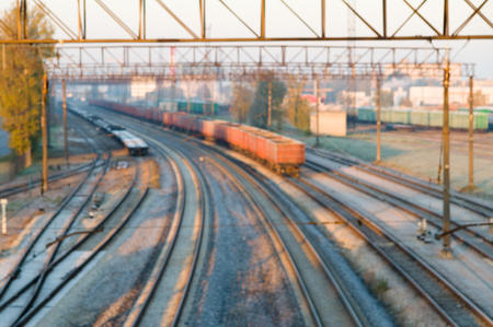 """Railroads and rail-cars in an industrial zone - """"the US plans to build locomotives in India"""""""