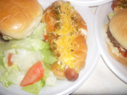 Ultimate burgers and hot dogs with fresh lettuce and tomato salad