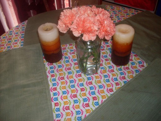 pink carnations and candles