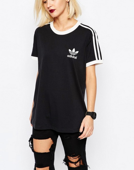 This black and white Adidas shirt goes well with black jeans to create a monochromatic look.