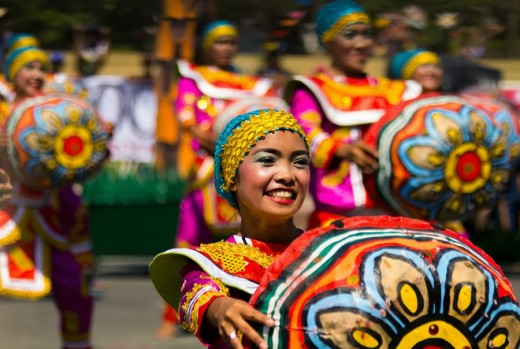 Filipinos are happy people. Celebrating the annual Aliwan Fiesta in Pasay City, Philippines