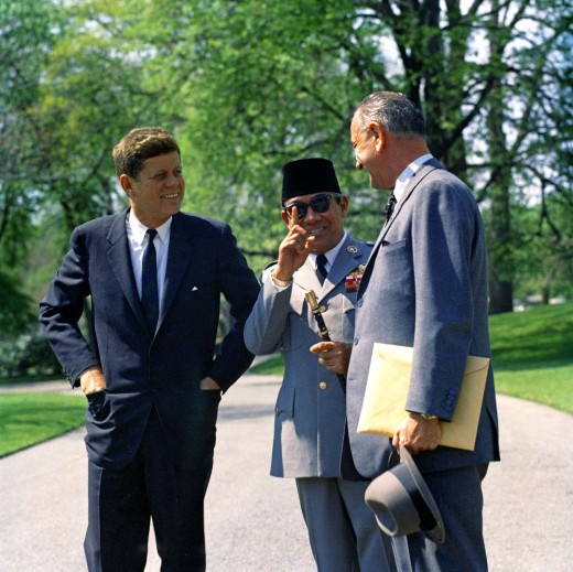 This photo was taken on April 25, 1961.U.S. President John F. Kennedy shakes hands with President of Indonesia Ahmed Sukarno before President Sukarno's departure, South Lawn, White House, Washington, D.C. Vice President Lyndon B. Johnson looks on.
