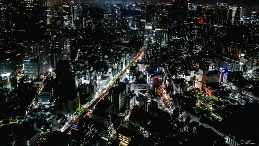 A vibrant night image of Tokyo's bustling streets in Japan.