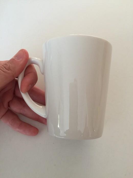 A cheap white ceramic cup.