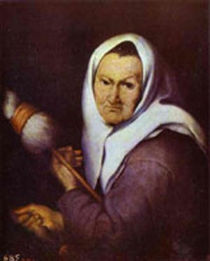 A woman holding either a distaff or broom.