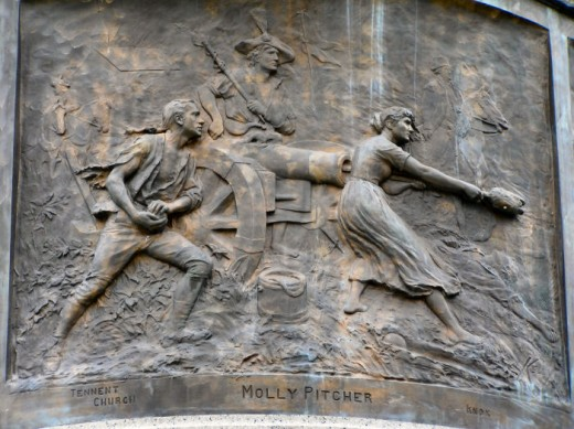 Carving of Molly Pitcher on the monument outside the Freehold Courthouse