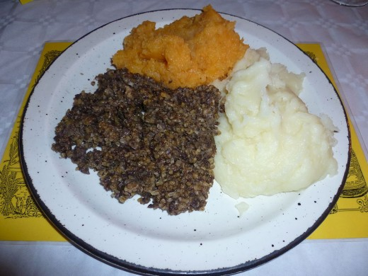 Haggis (dark colored) often goes with neeps (yellow)and latties (white)