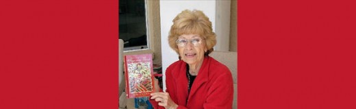 Photo of Marge Tindall at a book signing. Used with permission.