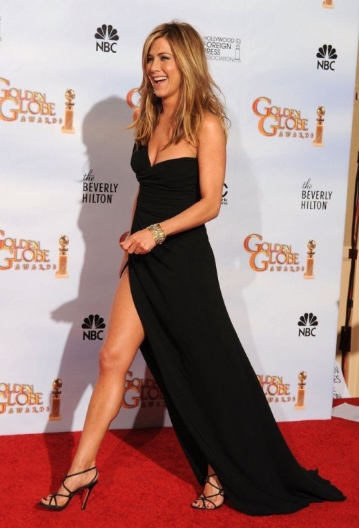 Jennifer Aniston patrolling the red carpet in a thigh high slit full length black dress