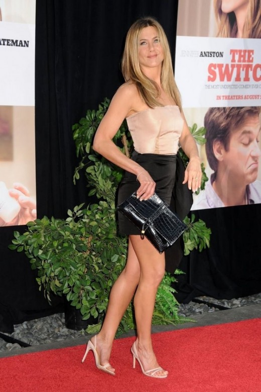 Jennifer Aiston on the red carpet in a strapless mini dress and slingback high heels