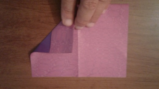 After flipping, fold one corner down