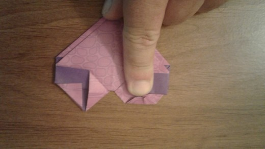 "now fold down the ""tops"" of the triangles"