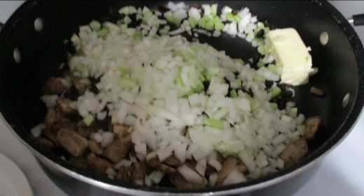 start with melted butter, add onions, celery, fresh mushrooms, raisins, and minced garlic.
