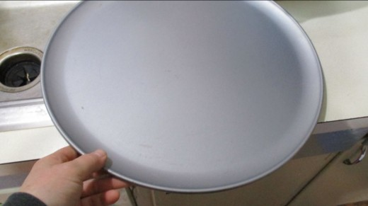 This is a very large pizza pan.