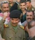 Saddam Hussein with an Army behind him