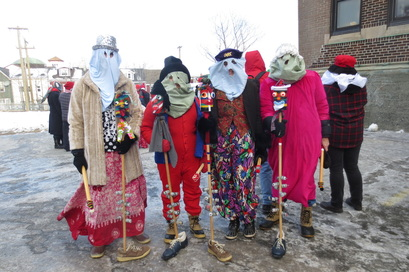 Newfoundland Mummers With One of Their Traditional Musical Instruments, the Ugly Stick