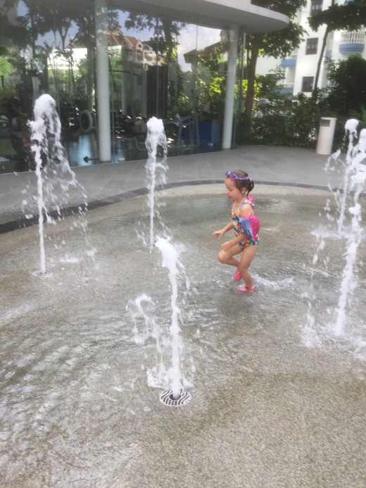 Children's water play. Gym in the background.