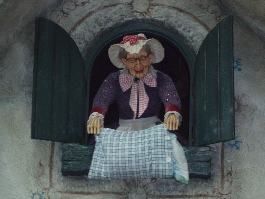 Frau Berchta (Holle) shaking out the goose-down. See the resemblance to Mother Goose here?