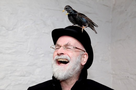Terry Pratchett with some birds on his head.